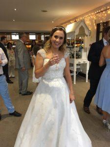 Bride in sparkly wedding dress on a wedding budget