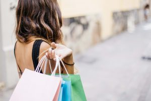 confessions of a shopaholic - lady carrying shopping bags